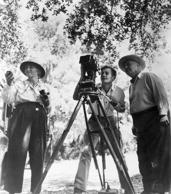 Director Robert Flaherty (right, 1884 - 1951) stands with his wife and collaborator Frances Flaherty.