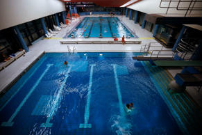 General view of the inside of a public indoor swimming pool.