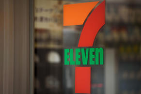 The 7-Eleven logo is displayed at a convenience store, operated by Seven & i...