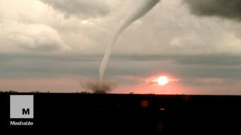 Tornado forms as the sun sets in surprisingly beautiful footage