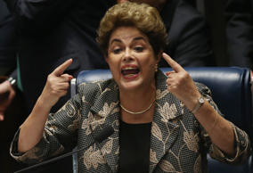Suspended President Dilma Rousseff speaks while answering a question from a senator during her impeachment trial on Monday in Brasilia.