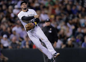Colorado Rockies third baseman Nolan Arenado throws to first base to put out Arizona Diamondbacks' Brandon Drury during the fifth inning of a baseball game Friday, Sept. 2, in Denver. The Rockies won 14-7.