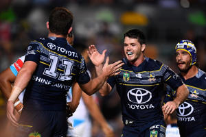 Gavin Cooper of the Cowboys celebrates with Lachlan Coote after scoring a try during the North Queensland Cowboys and the Gold Coast Titans match on September 3, 2016 in Australia.