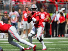 Ohio State Buckeyes quarterback J.T. Barrett (16) drops back against the Bowling Green Falcons at Ohio Stadium.