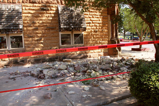 Stonework litters the sidewalk outside an empty jewelry store at the corner of Sixth and Harrison in Pawnee, Oklahoma, U.S. on Sep. 3, 2016 after a 5.6 earthquake struck near the north-central Oklahoma town.