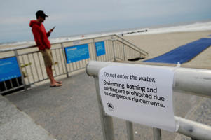 A sign warns of water closures at Rockaway Beach in Queens, New York on Labor Day due to post-tropical cyclone Hermine which tracked off the east coast of the U.S. September 5, 2016.