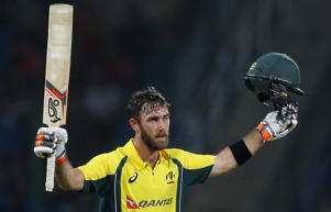 Australia's Glenn Maxwell celebrates scoring a century against Sri Lanka during their first twenty20 cricket match in Pallekele.