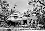 This is a Aug. 18, 1969 file photograph of an 85 foot boat that was deposited in the yard of Stafford Cooper in Biloxi, Miss., as part of the wreckage of Hurricane Camille. The boat's anchorage is more than 100 yards from the home and floated in on flood tides. Although it has been almost 40 years, since the Category 5 storm hit the Gulf Coast, Hurricane Camille is still one of the benchmarks by which all hurricanes are measured.