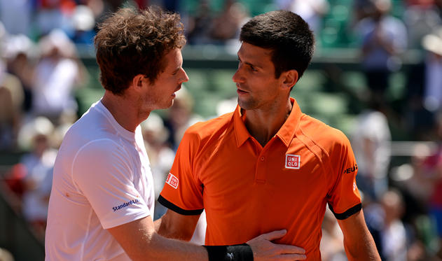Slide 1 of 25: Andy Murray pictured with rival Novak Djokovic after their Men's singles Semi-finals on day fourteen of the French Open.