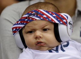 United States' Michael Phelps' son Boomer wears ear protection during the swimming competitions at the 2016 Summer Olympics, Monday, Aug. 8, 2016, in Rio de Janeiro, Brazil. (AP Photo/Michael Sohn)