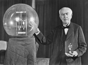 Noted inventor Thomas Edison at the lightbulb's golden jubilee anniversary banquet in his honor, Orange, New Jersey, October 16, 1929. He is exhibiting in his hand a replica of his first  successful incandescent lamp which gave 16 candlepower of illumination, in contrast to the latest lamp, a 50,000 watt, 150,000 candlepower lamp. (Photo by Underwood Archives/Getty Images)