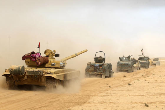Iraqi forces deploy on October 17, 2016 in the area of al-Shurah, some 45 kms south of Mosul, as they advance towards the city to retake it from the Islamic State (IS) group jihadists. Some 30,000 federal forces are leading the offensive, backed by air and ground support from a 60-nation US-led coalition, in what is expected to be a long and difficult assault on IS's last major Iraqi stronghold.