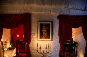 In this picture taken Oct. 9, 2016, a portrait of Vlad the Impaler is hung on a wall in Bran Castle, in Bran, Romania. Airbnb has launched a contest to find two people to stay overnight in the castle on Halloween, popularly known as Dracula's castle beca