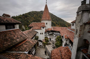 In this picture taken Oct. 9, 2016, men stand in the inner courtyard of Bran Castle, in Bran, Romania. Airbnb has launched a contest to find two people to stay overnight in the castle on Halloween, popularly known as Dracula's castle because of its conne