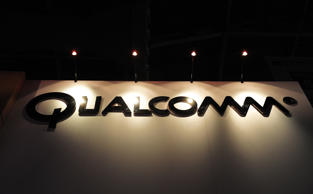 The Qualcomm logo sits above the entrance to the company's trade stand at the Mobile World Congress in Barcelona, Spain, on Wednesday, Feb. 16, 2011.