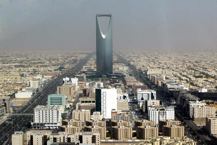 In this Monday, Oct. 6, 2003 file photo, Saudi Arabian capital Riyadh with the 'Kingdom Tower' photographed through a window of the 'Al-Faislia Tower' in the Saudi Arabian capital Riyadh.