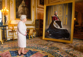 WINDSOR, UNITED KINGDOM - OCTOBER 14: Queen Elizabeth II views a portrait of herself by British artist Henry Ward, marking six decades of patronage to the British Red Cross, which has been unveiled at Windsor Castle on October 14, 2016 in Windsor, Englan