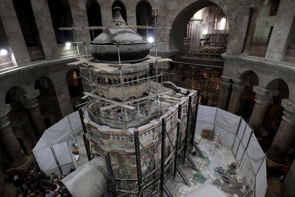 Greek preservation experts work to strengthen the Edicule surrounding the Tomb of Jesus, where his body is believed to have been laid, as part of conservation work done by the Greek team in Jerusalem on late on October 28, 2016