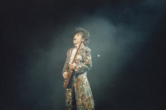 Slide 1 of 26: Oscar-winning rock singer Prince gives his final performance in Miami's Orange Bowl, Easter Sunday, April 8, 1985, before a crowd of an estimated 55,000 fans. (AP Photo/Phil Sandlin)