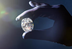 A flawless, oval-shaped diamond of 63.93 carats is shown at Christie's, central London. The stone is expected to fetch around 4million when it is auctioned by Christie's Geneva on November 19. A rare 478-carat Ceylon sapphire, the largest sapphire ever to come up for auction, will also among the lots at the sale next month.