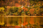 BRIG O' TURK, SCOTLAND - OCTOBER 25: A general view of Loch Achray on October 25, 2016 in Brig O'Turk,Scotland. After an unusually warm October and a mild autumn so far, trees in many parts of Scotland are starting to display their full autumn colours.