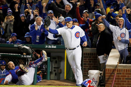 Chicago Cubs first baseman Anthony Rizzo reacts after catching a ball bounced off from catcher David Ross, left, who was trying catch a foul ball hit by Cleveland Indians' Carlos Santana during the second inning of Game 5 of the Major League Baseball World Series, Oct. 30, in Chicago, Ill.