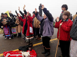 Protesters against the construction of the Dakota Access oil pipeline block a highway in near Cannon Ball, N.D., on Wednesday, Oct. 26, 2016. Law enforcement officials have asked people protesting the Dakota Access oil pipeline to vacate an encampment on private land, and the protesters said no. Protesters are trying to halt construction of the pipeline they fear will harm cultural sites and drinking water for the Standing Rock Sioux.
