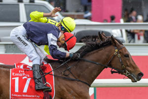 Kerrin McEvoy on Almandin is congratulated by Joao Moreira (HK) after winning Kerrin McEvoy wins Emirates Melbourne Cup.