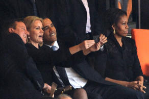 AFP PICTURES OF THE YEAR 2013 -- US President Barack Obama (R) and British Prime Minister David Cameron pose for a selfie picture with Denmark's Prime Minister Helle Thorning Schmidt (C) next to US First Lady Michelle Obama (R) during the memorial service of South African former president Nelson Mandela at the FNB Stadium (Soccer City) in Johannesburg on December 10, 2013. Mandela, the revered icon of the anti-apartheid struggle in South Africa and one of the towering political figures of the 20th century, died in Johannesburg on December 5 at age 95. AFP PHOTO / ROBERTO SCHMIDT (Photo credit should read ROBERTO SCHMIDT/AFP/Getty Images