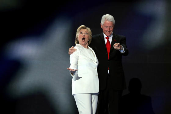 PHILADELPHIA, PA - JULY 28:  Democratic presidential candidate Hillary Clinton along with her husband, former US President Bill Clinton, acknowledge the crowd on the fourth day of the Democratic National Convention at the Wells Fargo Center, July 28, 201