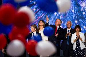 CLEVELAND, OH - JULY 21:  Republican nominee Donald Trump celebrates after the Republican Convention, July 21, 2016 at the Quicken Loans Arena in Cleveland, Ohio.  His is joined by his running mate Mike Pence and his wife Melania   (Photo by Brooks Kraft
