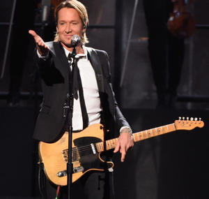 Keith Urban performs onstage at the 50th annual CMA Awards at the Bridgestone Arena