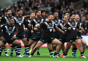 New Zealand players perform the Haka ahead of kick off during the Four Nations match between England and New Zealand Kiwis