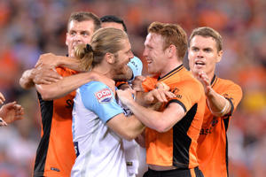 Corey Brown of the Roar and Luke Brattan of Melbourne City face off during the round five A-League match between the Brisbane Roar and Melbourne City FC at Suncorp Stadium on November 4, 2016 in Brisbane, Australia.