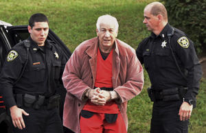 Convicted child molester Jerry Sandusky (C), a former assistant football coach at Penn State University, arrives at the Centre County Courthouse in Bellefonte, Pennsylvania October 29, 2015.