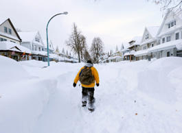 FILE - Brian Cintron walks in his snow-bound south Buffalo neighborhood on Thurs...