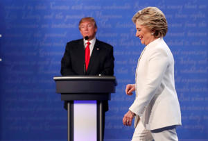 Democratic U.S. presidential nominee Hillary Clinton walks off the debate stage as Republican U.S. presidential nominee Donald Trump remains at his podium after the conclusion of their third and final 2016 presidential campaign debate at UNLV in Las Vegas, on Oct. 19, 2016.