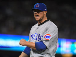 Chicago Cubs starting pitcher Jon Lester reacts after getting out of the seventh inning of Game 5 of the National League baseball championship series against the Los Angeles Dodgers Thursday, Oct. 20, 2016, in Los Angeles.