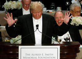 Republican U.S. presidential nominee Donald Trump makes a joke about hand size at the Alfred E. Smith Memorial Foundation dinner in New York, U.S. October 20, 2016.