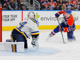 Oct 20, 2016; Edmonton, Alberta, CAN; St. Louis Blues goaltender Jake Allen (34) makes a save in the third period on Edmonton Oilers forward Connor McDavid (97) at Rogers Place.