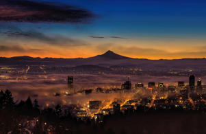 Fog rolling in at dawn over the city of Portland.