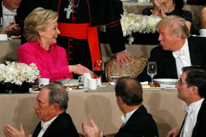 Democratic U.S. presidential nominee Hillary Clinton (L) and Republican U.S. presidential nominee Donald Trump (R) shake hands after their remarks at the Alfred E. Smith Memorial Foundation dinner in New York, U.S. October 20, 2016.