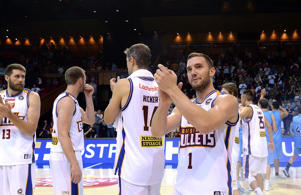 Adam Gibson of the Bullets and team mates celebrate their victory after the round three NBL match between the Brisbane Bullets and the New Zealand Breakers