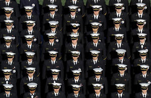 Members of the U.S. Naval Academy stand in formation on the field before an NCAA college football game between Navy and Memphis in Annapolis, Md., Saturday, Oct. 22, 2016.