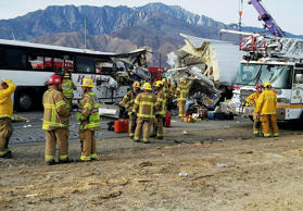 This photo provided by KMIR-TV shows the scene of a crash between a tour bus and a semi-truck crashed on Interstate 10 near Desert Hot Springs, near Palm Springs, in California's Mojave Desert Sunday, Oct. 23, 2016. Multiple deaths and injuries were reported.