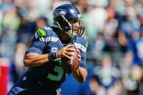 File photo of quarterback Russell Wilson #3 of the Seattle Seahawks scrambles against the Miami Dolphins at CenturyLink Field in Seattle, Wash.