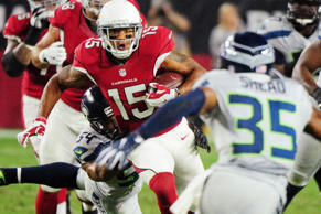Arizona Cardinals wide receiver Michael Floyd #15 carries the ball as Seattle Seahawks middle linebacker Bobby Wagner #54 and cornerback DeShawn Shead #35 defend during the first half at University of Phoenix Stadium on Oct. 23.