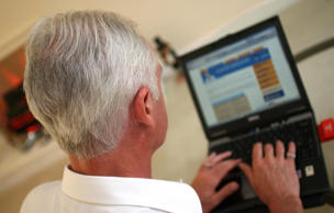 File photo of an elderly gentleman surfing the internet.