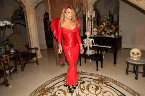 Mariah Carey poses for photos at her Halloween Party on October 22, 2016 in Los Angeles, California.