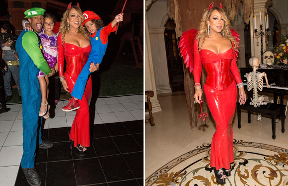 Slide 1 of 23: Nick Cannon, Monroe Cannon, Mariah Carey, and Moroccan Cannon attend Mariah Carey's Halloween Party.